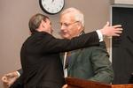 Mr. McGloin Congratulating Dr. Schure