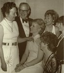 Dean and Mrs. Sherwood R. Mercer Giving Wishbone Pins to Student Wives. 1973