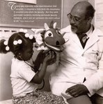 Oliver C. Bullock, DO. (1978), Director of Cabria Street Health Care Center, and His Puppet Show, 1993